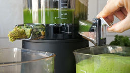 Slow juicer is making kale, mint and apple juice. Green juice 1 Footage