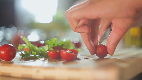Lady cutting cherry tomatoes for family dinner, hobby, balanced nutrition Live Action