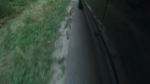 Side view of high speed moving car, holiday journey, environmental pollution Live Action