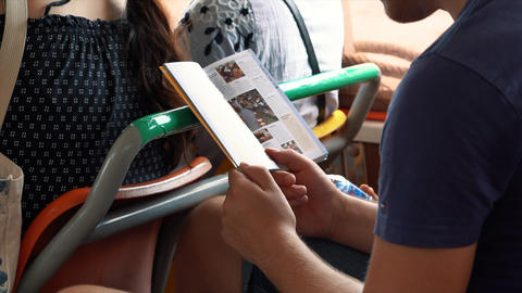 Young traveler reading a guidebook in the public transport Footage