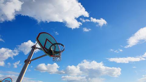 Clouds passing over a basketball hoop in California Archivo