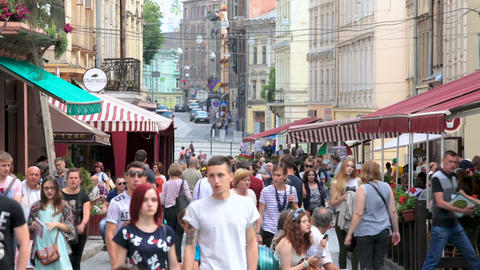 LVIV, UKRAINE - CIRCA JULY 2017: People in the city. Many people walking down Footage