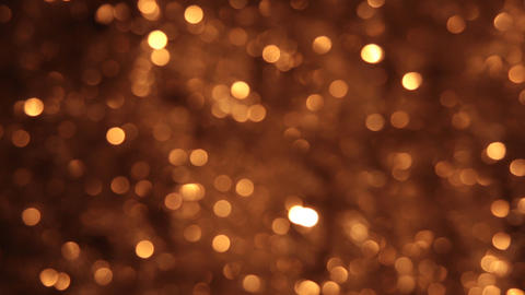 Wind shakes bokeh from gold tinsel Footage