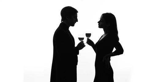 Silhouette of wealthy man getting acquainted with pretty lady at party, flirt Live Action