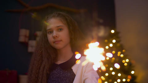 Charming girl with sparkler celebrating Christmas Footage