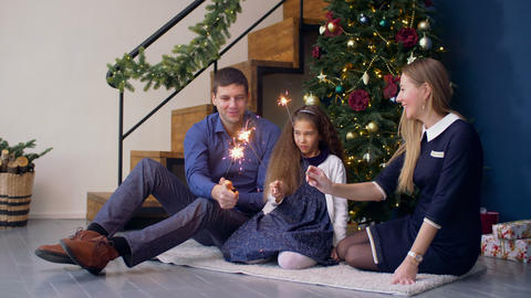 Happy family with sparklers celebrating Christmas Footage