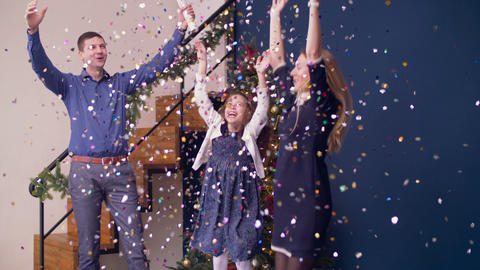 Excited family celebrating Christmas with firecracker Footage