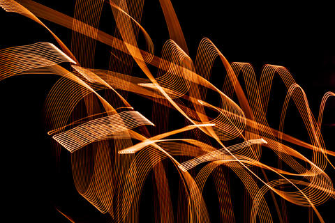 Bright spiral patterns from light strips on a black background フォト