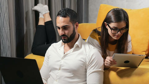 Family Couple Use Gadgets at Home Live Action