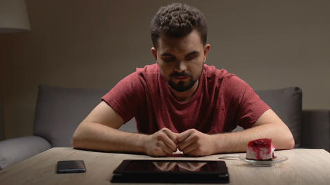 Worried man checking nervously smartphone and tablet, problem thoughts, despair Live Action