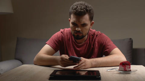 Worried man checking nervously smartphone and tablet,... Stock Video Footage