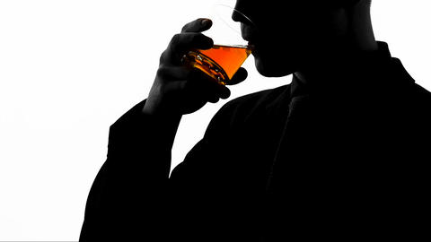 Relaxed businessman drinking cognac after workday, enjoying taste of beverage Live Action