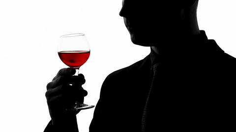 Professional sommelier tasting expensive alcoholic beverage, man drinking cognac Live Action