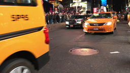 NEW YORK CITY - CIRCA OCTOBER, 2015: Yellow Cabs speed up along city streets at  Footage