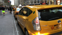 NEW YORK CITY - CIRCA OCTOBER, 2015: Yellow Cabs speed up along city streets in  Footage