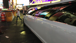 NEW YORK CITY – CIRCA OCTOBER, 2015: New York City Limousine in Times Square.  Live Action