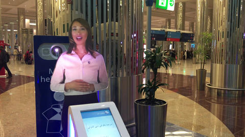 DUBAI - NOVEMBER 22, 2015: Dubai airport interior with virtual assistant. The ci Footage