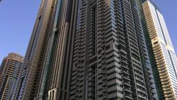 DUBAI - NOVEMBER 22, 2015: Dubai Marina Skyline. The City Attracts 14 Million Wo stock footage