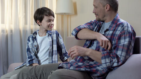Dad giving cash from wallet to son for new toys, child pocket money, finances Footage