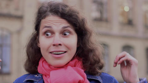 Emotional video-portrait of a surprised woman Footage