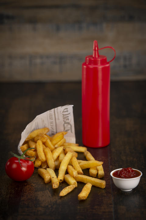 French fries in a paper bag Photo