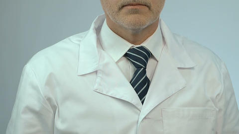 Portrait of doctor with stethoscope, offering quality... Stock Video Footage