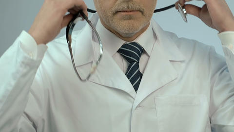 Portrait of doctor with stethoscope, offering quality clinic services, medicare Footage