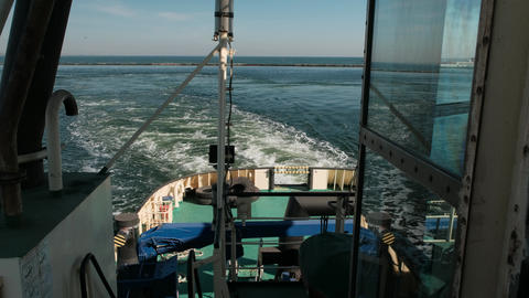 Tug Boat. View of the stern of the vessel during the movement Live Action