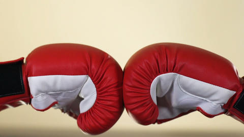 Two opponents hands in boxing gloves, sport competition, resistance, conflict 영상물
