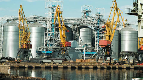 Cargo crane, ship and grain dryer in port A lorry with a trailer rides on the Footage