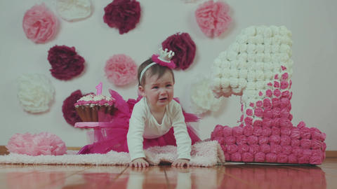 The first birthday of a little princess. Dissatisfied girl at birthday Live Action
