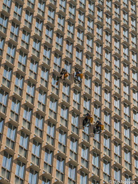 Window cleaners outside an office buildings Photo