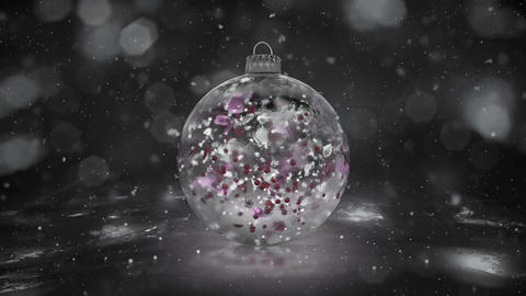 Christmas Rotating White Ice Glass Bauble snow colorful petals background loop Animation