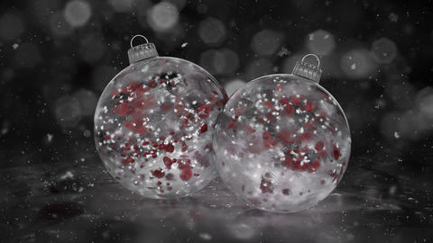 Two Rotating Christmas White Ice Glass Baubles snow red petals background loop Animation