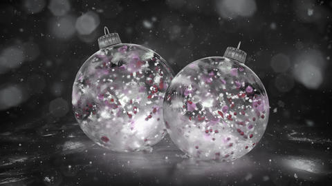 Two Rotating Christmas White Ice Baubles snow colorful petals background loop Animation