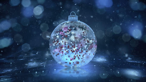 Christmas Rotating Blue Ice Glass Bauble snow colorful petals background loop Animation