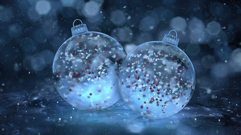 Two Rotating Christmas Blue Ice Glass Baubles snow red balls background loop Animation
