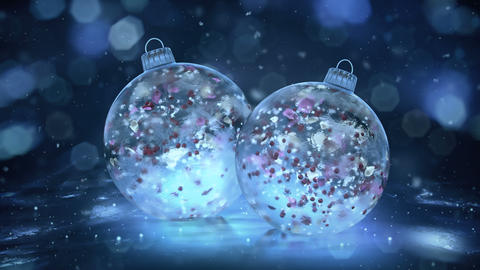 Two Rotating Christmas Blue Ice Baubles snow colorful petals background loop Animation