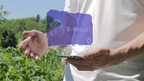 Man shows concept hologram E-wallet on his phone Footage