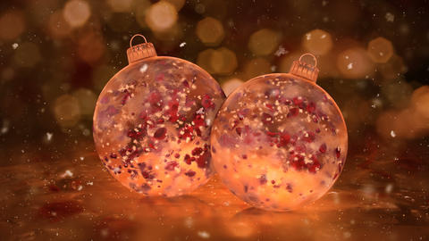 Two Rotating Christmas Golden Ice Glass Baubles snow red petals background loop Animation