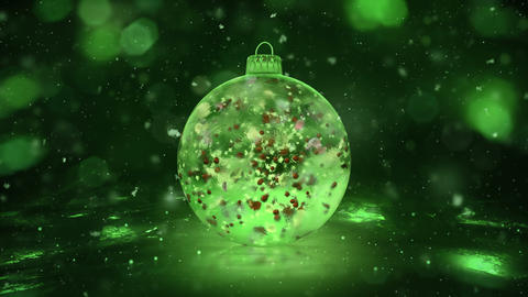 Christmas Rotating Green Ice Glass Bauble snow colorful petals background loop Animation