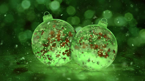 Two Rotating Christmas Green Ice Glass Baubles snow red petals background loop Animation