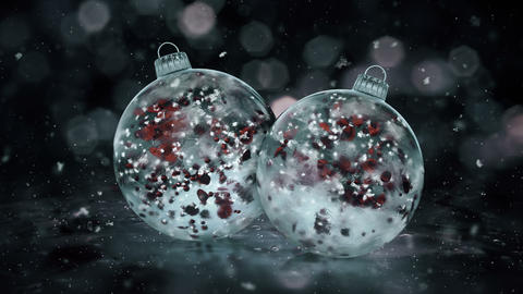 Two Rotating Christmas Grey Noir Ice Glass Baubles red petals background loop Animation