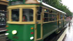 MELBOURNE – NOVEMBER 2015: View of people in the vintage green and yellow tram Footage