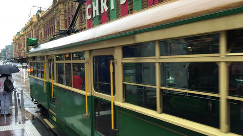 MELBOURNE – NOVEMBER 2015: View of people in the vintage green and yellow tram Live Action