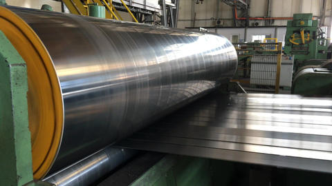 Steel coils cutting machine in industrial factory Footage