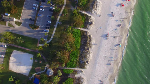 Overhead view of beautiful tropical beach with people on the seaside Footage