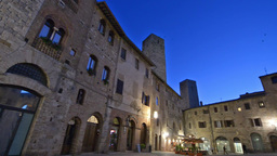 SAN GIMIGNANO, ITALY – APRIL 16, 2016: Tourists in city center at night. San G Footage