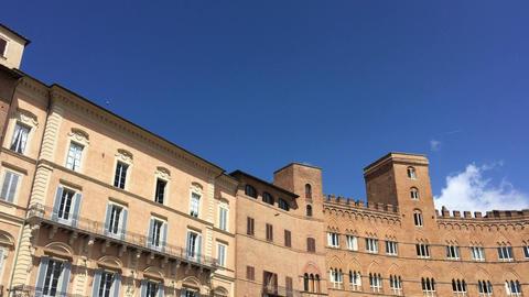 SIENA – APRIL 2016: Tourists in Piazza del Campo. Siena is a major destination Live Action