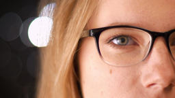 Close-up shooting of pretty half-face in spectacles of blonde caucasian woman Footage